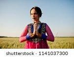 tender indian girl in saree ... | Shutterstock . vector #1141037300