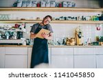 caucasian male owner of coffee... | Shutterstock . vector #1141045850
