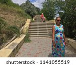the long staircase descends... | Shutterstock . vector #1141055519