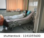 young woman in hospital on a... | Shutterstock . vector #1141055600