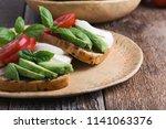 grilled whole grain bread... | Shutterstock . vector #1141063376