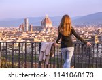 girl looking at the city of... | Shutterstock . vector #1141068173