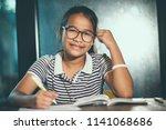 asian teenager wearing eye... | Shutterstock . vector #1141068686