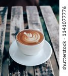 coffee latte art on wooden... | Shutterstock . vector #1141077776