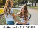 worried mother. beautiful... | Shutterstock . vector #1141086320