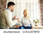 woman in optics store having... | Shutterstock . vector #1141107893