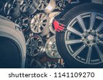 picking new alloy wheels. car... | Shutterstock . vector #1141109270