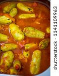 stuffed zucchini in a tomato...   Shutterstock . vector #1141109963