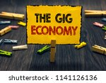 word writing text the gig... | Shutterstock . vector #1141126136