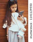 little girl child taking... | Shutterstock . vector #1141129550