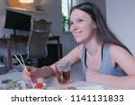 young woman brunette eats rolls ... | Shutterstock . vector #1141131833