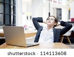 Portrait of relaxed businesswoman with laptop computer at cafe - stock photo