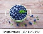 bowl full of blueberries  ... | Shutterstock . vector #1141140140