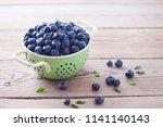 bowl full of blueberries  ... | Shutterstock . vector #1141140143