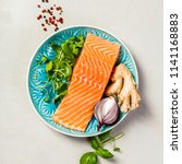 raw salmon fillet and... | Shutterstock . vector #1141168883