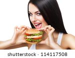 beautiful brunette woman biting hamburger on white background - stock photo