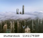 skyscrapers above the dramatic... | Shutterstock . vector #1141179389