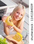 beautiful young woman eating... | Shutterstock . vector #1141184039