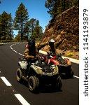 two men ride the mountain road...   Shutterstock . vector #1141193879