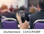 hand hold microphone in meeting ... | Shutterstock . vector #1141194389