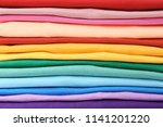 stack of colorful t shirts ... | Shutterstock . vector #1141201220