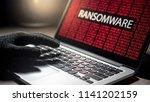 Male Hacker Hand On Laptop...