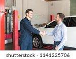 satisfied customer shaking... | Shutterstock . vector #1141225706