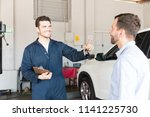 automobile mechanic giving car... | Shutterstock . vector #1141225730