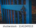 a blue gated entrance with a... | Shutterstock . vector #1141249313