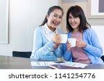 asian mother daughter pose... | Shutterstock . vector #1141254776