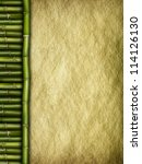 Template background - old, crumpled paper and bamboo - stock photo