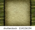 Template background - old handmade paper sheet on bamboo - stock photo
