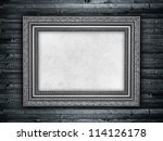 Template - paper sheet in picture frame on wood background - stock photo