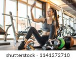 fitness girl taking selfie... | Shutterstock . vector #1141272710