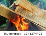 firewood burning in the brazier.... | Shutterstock . vector #1141274423