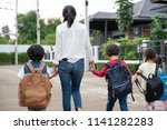 group of mother and kids... | Shutterstock . vector #1141282283