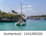 white yacht in a beautiful sea... | Shutterstock . vector #1141285220