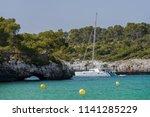white yacht in a beautiful sea... | Shutterstock . vector #1141285229