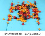 colorful autumn berries on blue ... | Shutterstock . vector #114128560