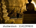 Statues In The Ancient Cave Of...