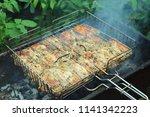 preparation of a shish kebab... | Shutterstock . vector #1141342223