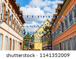 street with traditional houses... | Shutterstock . vector #1141352009