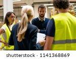 warehouse staff meeting | Shutterstock . vector #1141368869