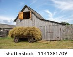 old cart with hay on the... | Shutterstock . vector #1141381709