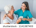 happy senior woman talking with ... | Shutterstock . vector #1141387403