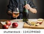 male hands holding bottle of... | Shutterstock . vector #1141394060