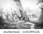 the parent holding the child's... | Shutterstock . vector #1141394126