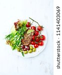 grilled pork with roasted... | Shutterstock . vector #1141403069