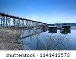 the longest wooden bridge and... | Shutterstock . vector #1141412573
