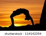 gymnast in sunset | Shutterstock . vector #114142354